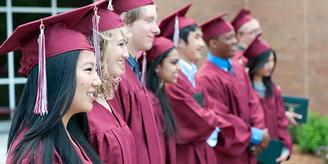 SABIS school seniors in their cap and gown lined up side-by-side on graduation day